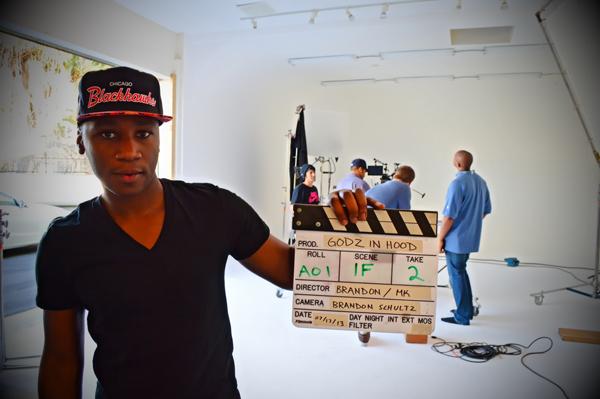 MK Asante with film slate